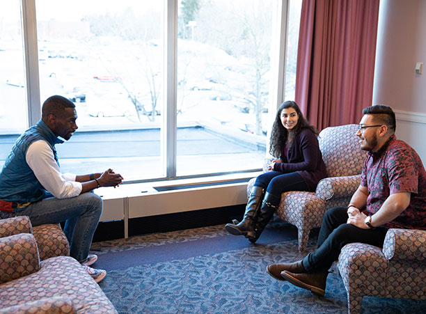 DeRay McKesson sits in a chair across from Mithra Salmassi