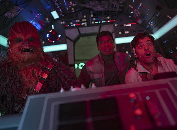 Three characters from Star Wars fly a space ship
